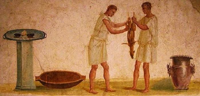 Seinämaalaus roomalaisista orjista valmistamassa ateriaa. Getty Villa, Malibu.