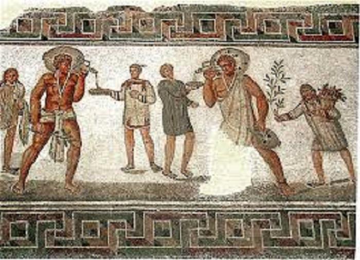 Roomalainen mosaiikki, joka kuvaa orjia kantamassa viinitynnyreitä. Tunisiasta löydetty mosaiikki 200-luvulta.