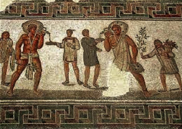 Orjia kantamassa viinikannuja. Roomalainen mosaiikki toiselta vuosisadalta. Dougga, Tunisia.